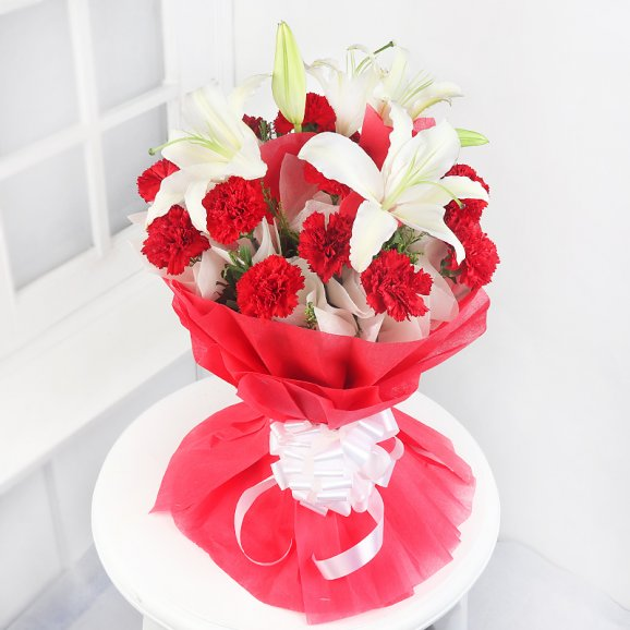 white lilies and red carnations bunch